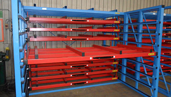 Drawers with spacers for loading sheets with forklift